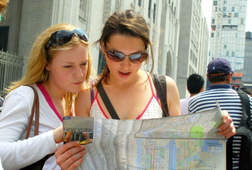 1024px-Two_girls_reading_map_of_NYC